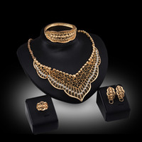 Wholesale crystals pieces - Rings Necklaces Earrings Bracelets Jewelry Sets Fashion Women Rhinestone 18K Gold Plated Hollow Out Leaves Wedding Jewelry 4-Piece Set JS042