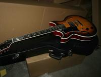e-gitarre halb hohl links großhandel-Gitarre der Gewohnheit 12 Saiten linkshändige Gitarren-Sonnendurchbruch-Hohlkörperjazz elektrische Gitarre freies Verschiffen