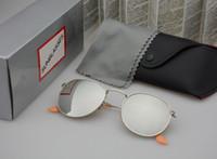 marcos redondos al por mayor-Gafas de sol redondas clásicas Mujeres de los hombres marca diseñador montura metálica Gafas de conducción vintage Uv400 Gafas Gafas de sol unisex con estuche y estuche