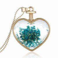 ingrosso blocco di cuore blu-New beautiful Pendenti cuore collana di cristallo lega Amore lago d'oro blu fiore fase pendente collana medaglione collana pendente di cristallo