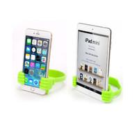 pulgares de iphone al por mayor-Soporte para teléfono Cama del pulgar Celular Smartphone Tableta Accesorio Soporte de soporte Mesa de escritorio Stents para iPhone / Samsung