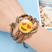Wholesale Women Kissing Leather - Emoji Leather Bracelet Infinity Handmade Butterfly Braided Bangles Expression Smile Cry Kiss Eye Faces Pendant Wristband Women Jewelry Gift