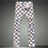 jeans blancos al por mayor-Los hombres de la manera del león de mezclilla pantalones vaqueros delgados del dril de algodón delgados delgados pantalones largos Pantalones pintados Envío gratis