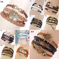 les gens libres en cuir achat en gros de-Infinity bracelets Les jeux de la faim Love Believe Charme Bracelets Silver lots Style Bracelets en cuir pour les gens de la mode DHL livraison gratuite