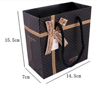 Wholesale Gift Bags Paper Bow - free shipping gift box packaging bags Speckle Clothing paper bag Bow decoration Gift packaging bags can be printed logo 15*14*7CM