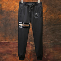 Wholesale Leather Clothes For Black Men - Free shipping New pants for men outdoors trousers mens Leather sequined skull clothes men's full nine plus size M-6XL