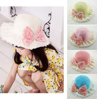 Wholesale Baby Bowler Hats - Baby Caps Girls Staw Hats Kids Lovely Bow Lace Pearl Beaded Caps Girl Bowknot Beach Sunbonnet Children Bowler Hat bucket Hat
