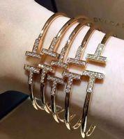 Wholesale T Steel Shaped - 2016 Cubic Zirconia two-letter T Shape Bangles Design Copper 18K Gold Plated Cuff Bracelet Bangle Cufflink Double T Bracelet Send Women vale