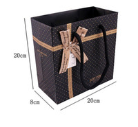 Wholesale Paper Clothing Packaging Box - free shipping gift box packaging bags Speckle Clothing paper bag Bow decoration Gift packaging bags can be printed logo 20*20*8cm
