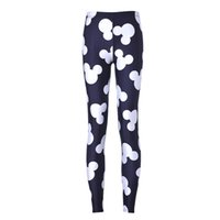 La moda europea e americana pantaloni il riso nero Stretch Leggings cartoon nero e bianco dispari soldi Yoga Pantaloni