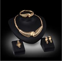 juegos de joyería india para la venta al por mayor-Alto grado Hollow Twist flower Jewelry Sets collar pulsera aretes anillos boda 18K joyas de oro familia de cuatro GTOMKS034