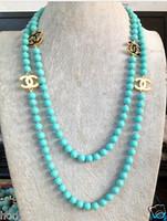 boucles d'oreilles collier de perles bleues achat en gros de-2016 chaud acheter perle jade bracelet bague boucle d'oreille collier pendentif NOUVEAU Top Long belle 8mm bleu Turquoise couleur coquille collier de perles 50