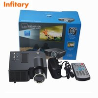 Wholesale Free ship hot UC28 Mini LED Digital Video Game Projectors Multimedia player Inputs AV USB SD HDMI proyector Speaker data show