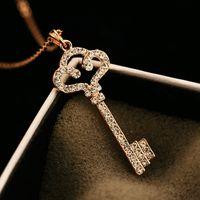 ingrosso catene placcate oro di qualità superiore-Top Quality Luxury Cubic Zirconia Collana con ciondolo chiave Collana a girocollo con catena design per donna