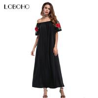 Vestido negro largo flores rojas
