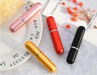 botellas de perfume de colores al por mayor-Botella recargable portátil del aerosol Botella colorida del aerosol Botellas vacías de los cosméticos del perfume