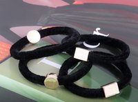 cintas para el pelo de metal al por mayor-Lazos de terciopelo de buena calidad con el famoso logotipo de metal decoración pelo cuerda velet clásico patrón 10pcs mucho