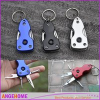 Wholesale 7 in key ring multi tools survival tool camping folding pocket multifunction tool with led light bottle opener