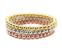 bracelets plaqués or 24 carats achat en gros de-Gros 10pcs / lot 6mm 24K or réel, or rose, platine plaqué perles de cuivre rond hommes femme cadeaux d'anniversaire bracelet extensible