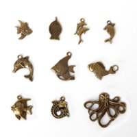 Wholesale Dolphin Necklace Mix - Free shipping New Wholesale 48pcs Vintage Charms Mixed Fish and Dolphin Pendant Antique bronze Fit Bracelets Necklace DIY Metal Jewelry Mak