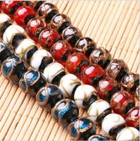 ingrosso porcellana di pietra del braccialetto-Perline di pietra rotonda 14mm 16mm fatti a mano per collana di braccialetto oro modelli di sabbia Perle di vetro di Murano dell'annata Cina in vendita