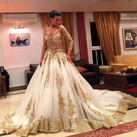 Wholesale wedding lace embellished resale online - Saudi Arabic Wedding Dresses V Neck Long Sleeve Gold Appliques embellished with Bling Sequins Sweep Train Amazing Party Dresses Formal