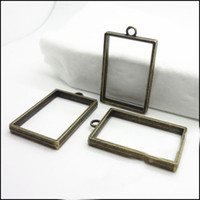 Wholesale Wholesale Rectangle Cameo Settings - 20PCS Vintage Antique Bronze Photo Frame Hollow rectangle Charms Pendant tray Base Setting Cabochon Cameo Pendant 37x23mm