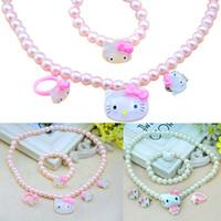 ingrosso gattino insieme dei monili-PrettyBaby Candy colore ragazze simulato collana di perle set anello orecchini braccialetto Carino Bambini ciao kitty collana di gioielli 4 pezzi set