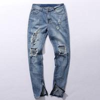 mavi ışık yıldızı toptan satış-Hip hop Kanye West Same jeans Erkekler Açık Mavi tasarımcı rock yıldızı Ripped Skinny sıkıntılı Fermuar kot Tahrip
