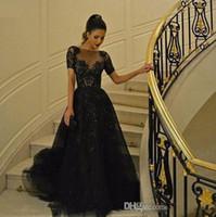 vestidos de noche largos fruncidos al por mayor-Mangas cortas Vestidos de noche negros de Elie Saab Abalorios de abalorios Vestidos largos de tul fruncido Vestidos de noche Vestidos con apliques de encaje