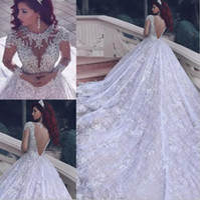 Wholesale Long Crystal Sequin Trains - Luxury Bling Crystal Beaded Sequin Arabic Dubai Lace Wedding Dresses 2017 Illusion Long Sleeve Sheer Back Chapel Train Bridal Gowns EN8249