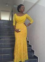 vestidos de novia largos vestidos amarillos al por mayor-Nigerian Fashion Yellow Lace Prom Scoop mangas largas sirena palabra de longitud noche vestido de fiesta de la novia africana