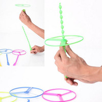 Wholesale Wholesale Flying Saucers - Lowest price helicopter flying toys Hand push flying saucer and frisbee Hand rotation outdoor toys for Children's Day kids toys
