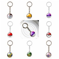 Wholesale Mixed Charms Metal Bronze - Anime Poke GO Ball Logo Key Rings Antique Bronze Silver Plated Gemstone Keychains Mixed 8 Designs Charm Jewelry For Women Men Fans