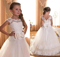 Wholesale 2016 Flower Girl First Communion Dresses Scoop Backless With Appliques and BowTulle Ball Gown Pageant Dresses For Little Girls