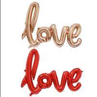 Wholesale Valentines Wedding Supplies - 108*64cm Ligatures LOVE Letter Foil Balloon Anniversary Wedding Valentines Party Decoration Balloon Red Champagne CCA6870 250pcs
