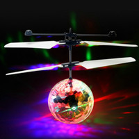 Wholesale Induction Lighting Free Shipping - New Flying LED toys RC Colorful Crystal Ball Aircraft Induction Helicopter Quadcopter Kids Light Up balls Toys Chrismas Gifts free shipping