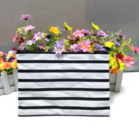 Wholesale Cosmetic Wholesale Suppliers - black&white stripe thick cotton canvas makeup bag with black lining black-gold zip striped cosmetic bags supplier