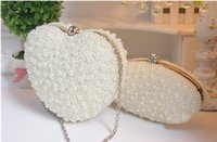 Wholesale Ivory Pearl Wedding Handbag - Amazing Cheap Full Double Heart Pearls Beaded Ivory Bride's Wedding Bags 2016 One Shoulder Crutch Evening Handbags