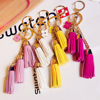 Wholesale Wholesale Silver Ball Ornaments - KEYRING 2016 Tassel Camellia Leather Tassels Keychain Bag Pendant Car Ornaments Creative Gifts Long Key Chain Buckle Key Ring Mixed Desings