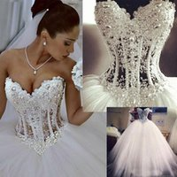 Wholesale Tops Pearl Necklines - Princess Puffy Ball Gown Wedding Dresses Pearls Beaded Illusion Boned Top Soft Tulle Floor Length Bridal Gowns Sweetheart Neckline