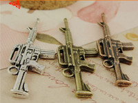 Wholesale Male Machine Gun - A3619 17*45MM Antique Bronze Handmade vintage male jewelry materials ZAKKA military jewelry retro alloy gun pendant, Machine gun charm