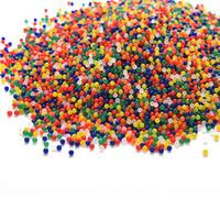 perlas de agua de jalea de perla mágica al por mayor-10000pcs / paquete en forma de perla de cristal del suelo de barro de agua perlas Grow ventas al por mayor del suelo de la jalea mágica Bolas Decoración del Aqua