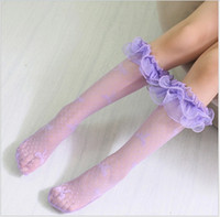 Wholesale Girls Knee High Tube Socks - 2016 Girls Lace Socks Children Lace Net Yarn Stockings Cute Girl Bowknot Middle Tube Socks Kids Knee-High Stocking Free Size 4 Colors