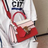 Wholesale Blue Cross Small Business - wholesale brand fashion elegant woman handbag bag butterfly diamond clamshell handbag color stripe stitching leather handbag fan in Europe