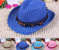 Wholesale Flat Hats For Kids - Free Shipping Panama Straw Hats Summer Foldable Caps for Kids Fashion Beads Stingy Brim Caps Solid Color Sun Hats