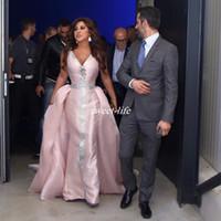 bebé sexy satinado al por mayor-Myriam Fares Vestidos de noche Baby Pink Ruffle Overskirts Satin Crystals V Neck Mermaid Plus Size 2020 Celebrity Party Dress Vestidos de baile árabe