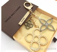 Wholesale Shell Holder Plastic - 1:1 Bag Charm Key Holder flowers perforated Mahina leather TAPAGE BAG CHARM M65090 Key Holder comes with Box