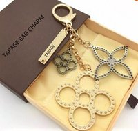 Wholesale Steel Round Lock - flowers perforated Mahina leather TAPAGE BAG CHARM M65090 Key Holder Box comes with free shipping dust bag