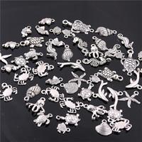 ingrosso mestiere dell'oceano-Dolce campana 60 pz misto argento antico mini oceano delfino shell pendente di fascini monili che fanno diy fascino artigianato fatti a mano h3003